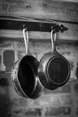 Antique pans hanging on a wooden beam