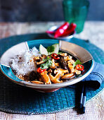 Sweet and sour chicken with mushrooms served with rice (Asia)