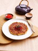 Okonomiyaki, pikanter japanischer Pfannkuchen