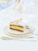 Meringue cake with vanilla cream and wild berry jam