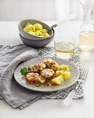 Monkfish in white wine and tomato sauce with potatoes