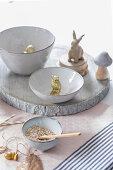 Autumnal arrangement of owl, rabbit and acorn decorations on table