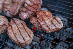 Raw beef loin steaks on a barbecue