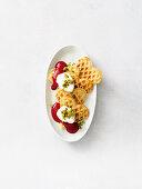 Sweet lupine waffles with raspberry sauce and cream
