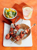 Grilled salmon tikka skewers with a yoghurt dip and cucumber salad