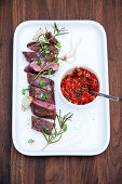 Grilled saddle of lamb with pointed cabbage salsa