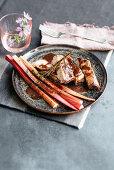 Pork ribs in red wine marinade with braised rhubarb