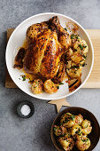 Stuffed roast chicken with salted lemons and spiced potatoes