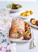 Crispy crackling pork with sweet onions and plums