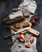Black baguette toasts with fresh strawberries, honey and mascarpone cheese