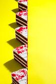 Red velvet cake on yellow background
