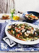Genovese seafood vegetable salad with salsa verde (Italy)