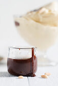 Rum and chocolate sauce for pine nut and coffee ice cream