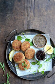 Trout fishcakes with beetroot jam and bitter leaves