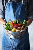 Man holding fresh vegetable