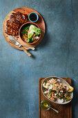 Teriyaki rib-eye pork steaks with stir-fried vegetables - Grilled endive and walnut salad