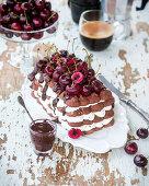 Chocolate meringue cake with cherries