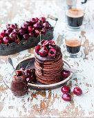 Chocolate pancakes with cherries