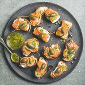 Salmon crostini with cream-cheese, watercress, capers and pesto sauce