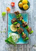 Mediterranean lamb and vegetable skewers with herb quark and potatoes