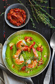Cream of pea soup with scampi, garlic, chilli paste and thyme