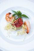 Tomato terrine with king prawns, zucchini, frisee salad and basil