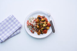 Fried aubergine and courgettes with pork escalope and tomato juice
