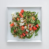 Oat salad with watermelon and pink pepper