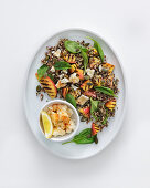 Quinoa with feta cheese, grilled peaches and baby spinach