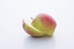 A Braeburn apple, halved