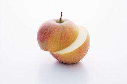 A Rubinette apple, halved