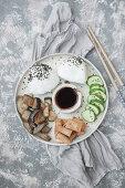 Buddha plate - Onigiri, fried tofu, cucumber, fried eggplant with miso sauce, soy sauce
