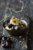 Baked cheese with dried plums