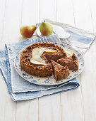 Bread casserole with pears, nuts and cocoa