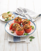 Gratin tomatoes filled with tuna, bread, and cheese