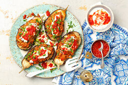 Baked aubergine, stuffed with meat and lenils
