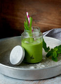 A green smoothie with fresh mint and spring onions