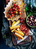Polenta Chips with prosciutto and roast tomato platter