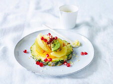 Winter fruit salad with madarin sugar, pineapple, persimmons, kiwifruit and pomegranate