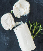 Slice of Goats Cheese with Goat Cheese Log