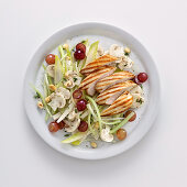 Grilled chicken breast with mushrooms, hazelnuts, grapes and lemon sauce