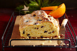 Orange yeast dough stollen with icing for Christmas