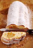 Orange and almond stollen filled with marzipan, orange peel and orange liqueur