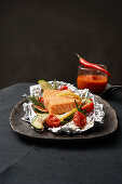 Foil roasted salmon with a pepper and tomato dip
