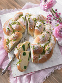 A pistachio yeast wreath with icing for Easter
