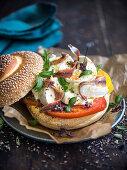 Pane cunzato (a roll with olive oil, tomatoes, buffalo mozzarella and oregano, Italy)