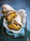 A ciabatta sandwich with chicken and grilled yellow courgette