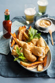 Fish in vodka batter with chips and Bloody Mary mayonnaise