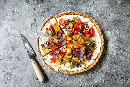 Tart with Heirloom Tomato and Ricotta on a gray background