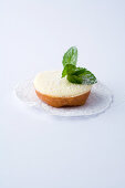 A mini tartlet with sour cream against a white background